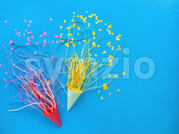 Holiday cap with tapes, confetti around on blue background. Holiday concept. Top view Stock Photo