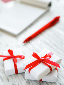 Table with gift boxes, note book. Letter concept. Top view Stock Photo