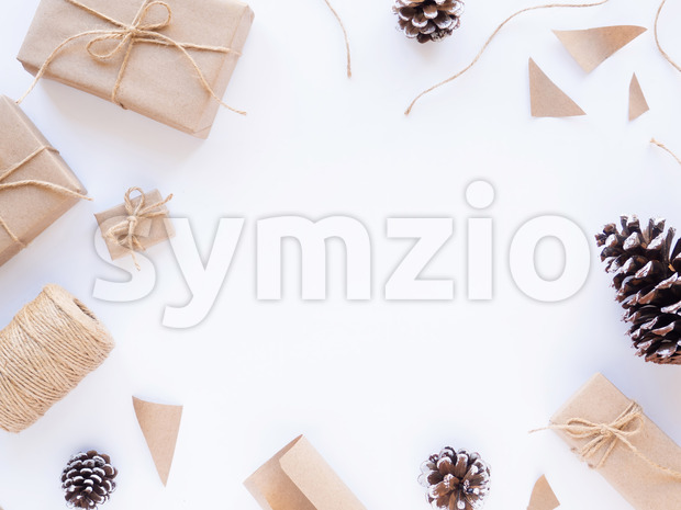 Gift boxes, bits of papers, fir cones, twine. White background. Holiday concept. Top view Stock Photo