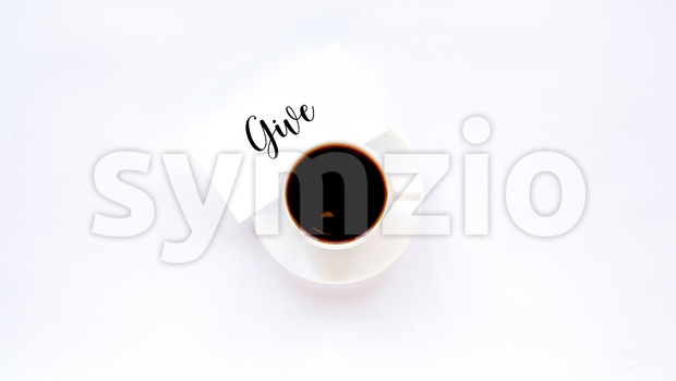 A cup of coffee on a white dish with a note with message. White background Stock Photo