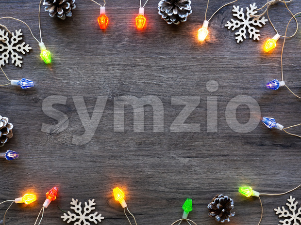 Christmas decorations, fir cones and illumination. Wooden background. Holiday concept. Top view Stock Photo