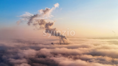 View of a thermal station in the distance above the clouds, columns of smoke, ecology idea Stock Photo