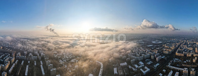 Panorama of Bucharest from a drone, districts of residential buildings, fog other the ground, Romania Stock Photo