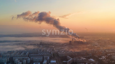 Cityscape of Bucharest from a drone, rows of residential buildings, thermal station with fog getting out and other the ground, ecology idea, Romania Stock Photo