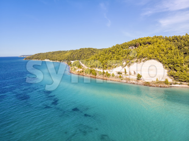 Aerial drone view of Fourka Skala sea and pine forest in Halkidiki, Greece Stock Photo