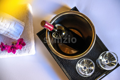 WIne bottle with glasses and flowers in a hotel room Stock Photo