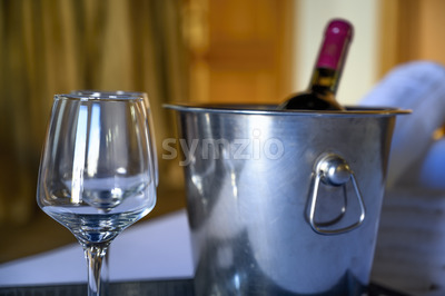 WIne bottle with glasses in a hotel room Stock Photo