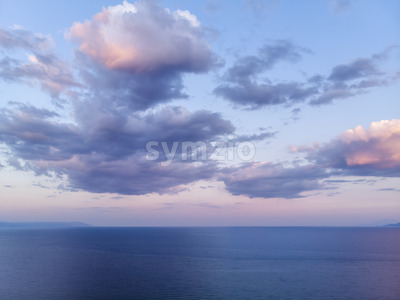 Dark blue and purple sky and sea after storm in Greece Stock Photo