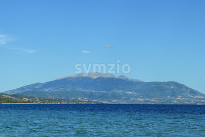 Blue background with mountains and sea in Greece Stock Photo