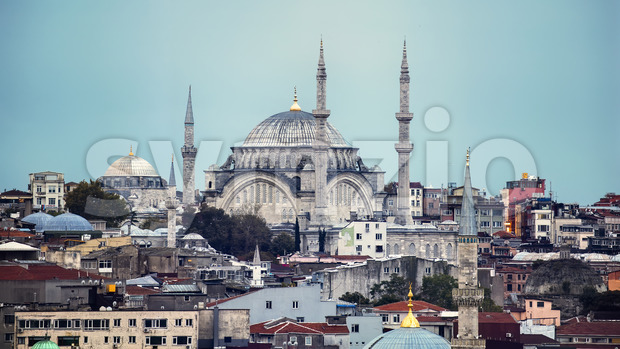 View of Nuruosmaniye Mosque with multiple residential buildings around it, cloudy weather in Istanbul, Turkey Stock Photo