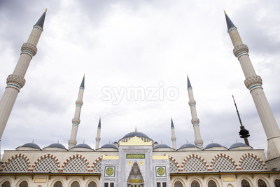 Front view of the Camlica Mosque with towers and domes, cloudy weather in Istanbul, Turkey Stock Photo