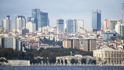 View of a district with residential and high modern buildings in Istanbul, Bosphorus Strait on the foreground, Turkey Stock Photo