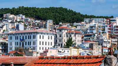 Levels of multiple residential and state buildings located on the hills in Kavala, Greece Stock Photo