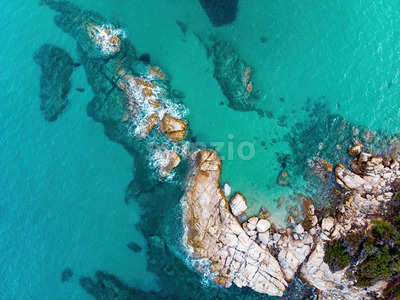 Rocky coastline of the Aegean sea with transparent blue water, view from the drone, Greece Stock Photo