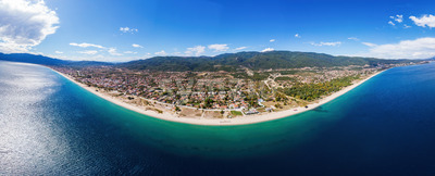 Panorama of Asprovalta and Aegean sea cost, multiple buildings, long beach along the town, green hills on the background, Greece Stock Photo