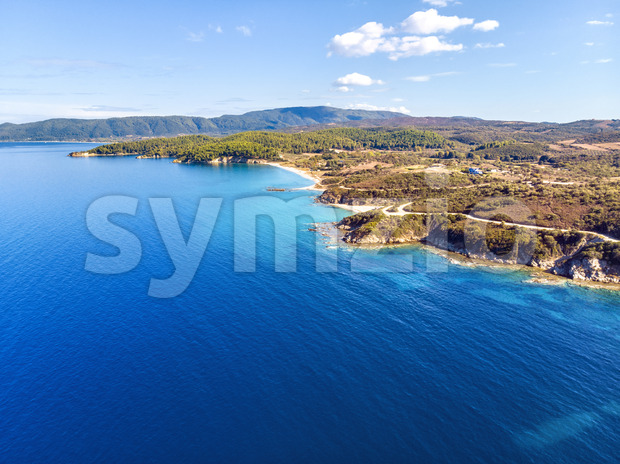 Church and sea with beach and mountains in Nea Roda, Halkidiki, Greece Stock Photo