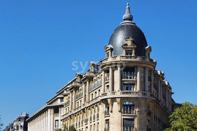 View on silver corner building wall with blue sky, paris city, france Stock Photo