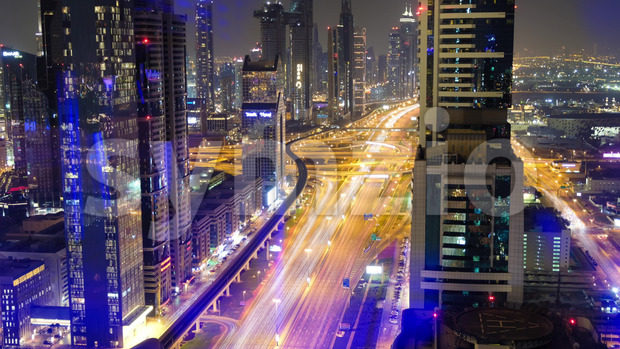 Aerial time lapse shot of moving traffic at night in the center of the city, UNITED ARAB EMIRATES