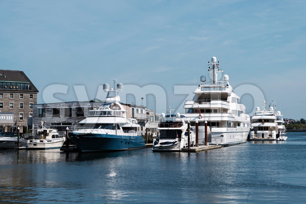 Buildings and boats at the port and harbor of Boston marina, USA Stock Photo