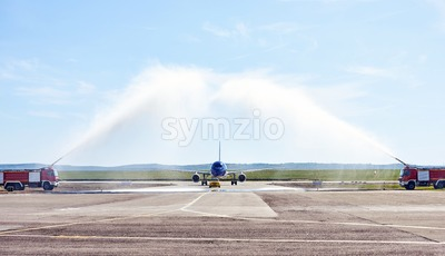 Airplane water salute procedure in Chisinau International Airport. Aviation day in Moldova Stock Photo