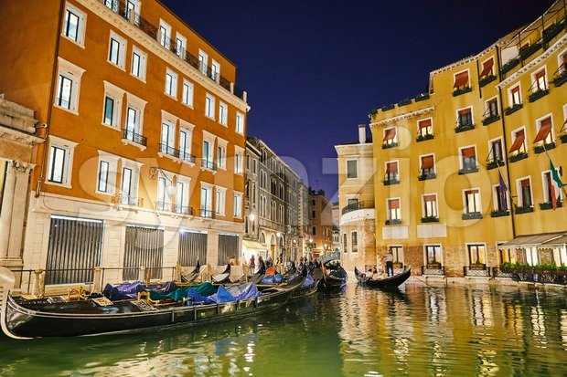 Night cityscape of Venice city colorful buildings on water. Place for text. Italy beauties