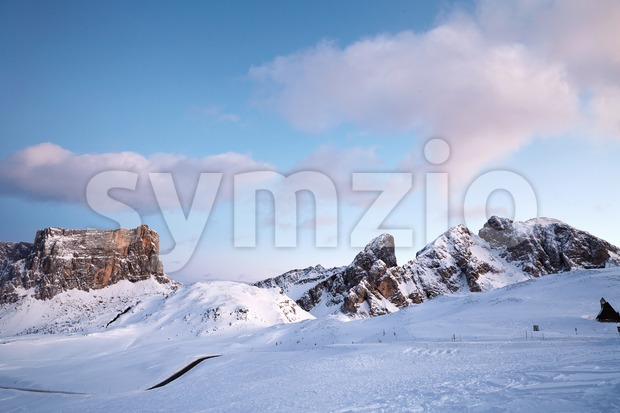 Giau Pass in winter season at pink sunset. Italy beauties