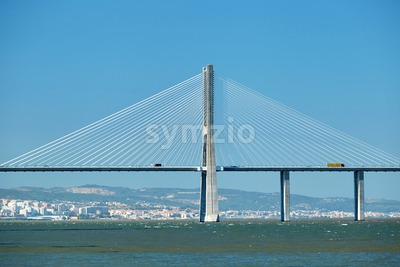 Vasco da Gama Bridge at daylight in close-up shot from side. Lisbon, Portugal Stock Photo