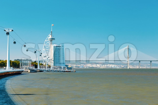 City and the sea with Vasco da Gama Bridge on background. Lisbon, Portugal Stock Photo