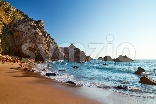 Ursa Beach under the cliff in stunning daylight colors. Lisbon, Portugal