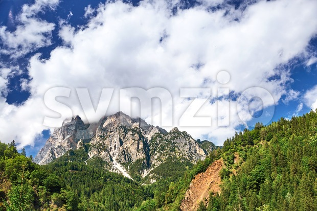 Mountains near San Candido village at daylight. White clouds on sky. Italy beauties Stock Photo