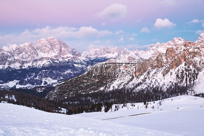 Cortina Ampezzo ski resort mountains covered in snow at sunset. Province of Belluno, Italy Stock Photo