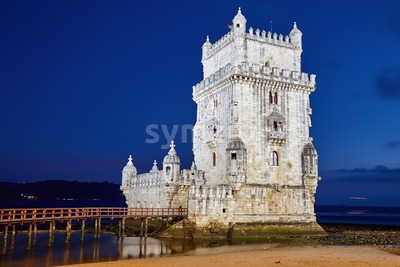 Belem tower at sunset blue hour. Clear sky on background. Lisbon, Portugal Stock Photo