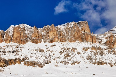 The Sassolungo Group massif covered in snow in Dolomites. Italy beauties Stock Photo