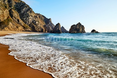 Ursa Beach coastline with rocks on background. Lisbon, Portugal Stock Photo
