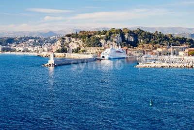 Nice city with ship parked in port at daylight. France beauties Stock Photo