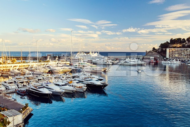 Monaco port at sunset. Parked yachts on foreground Stock Photo