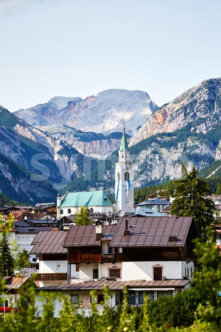 Cortina d'Ampezzo city with mountains on background. Belluno, Italy Stock Photo