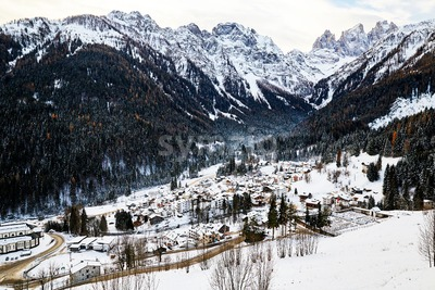 San Martino di Castrozza resort at daylight. Mountains covered in snow. Trentino, Italy Stock Photo