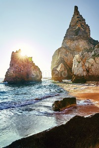 Ursa Beach coastline with rocks on background. Sun shining. Lisbon, Portugal Stock Photo