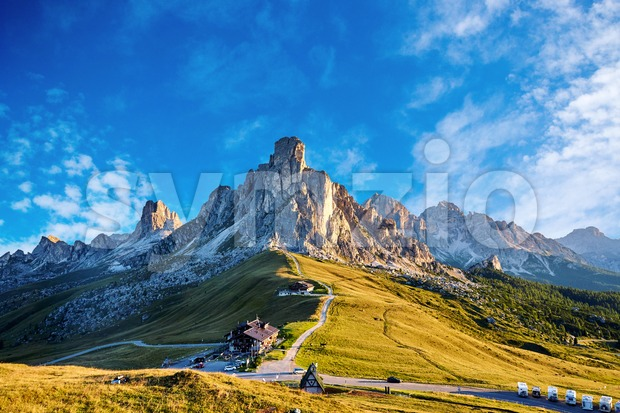 Giau Pass at daylight. Road to the mountain. Clear sky. Italy Stock Photo