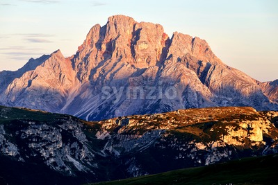 Cristallo mountain at sunset. Sun reflecting. Italy Stock Photo