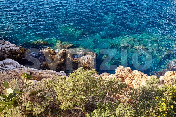 Cliff coast with beautiful blue water. Nice, France Stock Photo