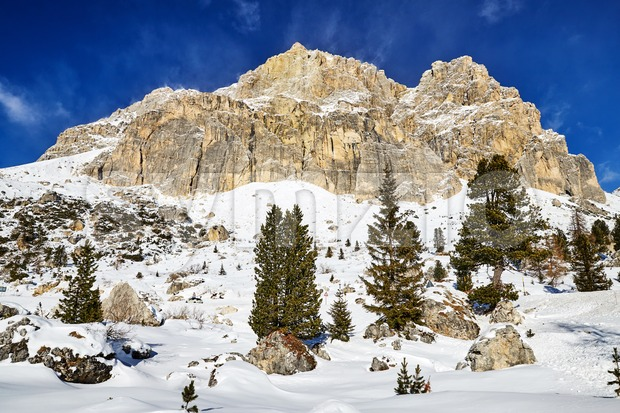 Dolomite mountains covered in snow. View from bottom. Italy Stock Photo