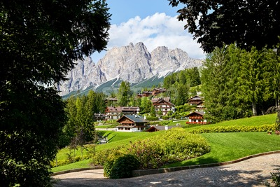 Cortina d'Ampezzo city at daylight. Mountains on background. Italy Stock Photo