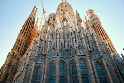 Sagrada Familia church from bottom view. Clear sunset sky, Barcelona, Spain Stock Photo