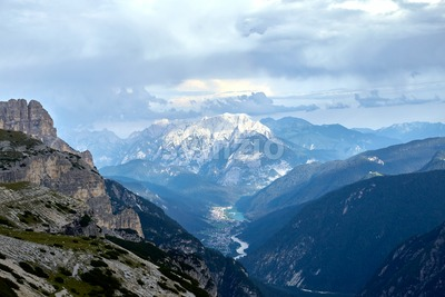 Mountains covered in snow above Auronzo di Cadore in Italy. Cloudy sky Stock Photo