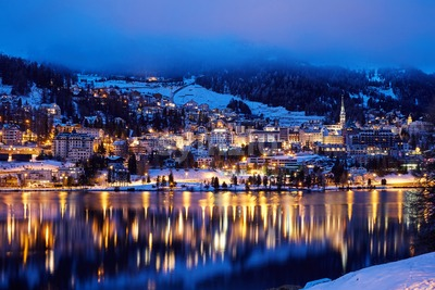 St. Moritz resort at night. Lights reflecting on lake. Switzerland Stock Photo