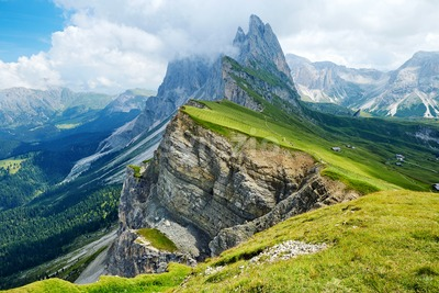 Seceda top of the mountain at daylight. Cloudy sky. Italy Stock Photo