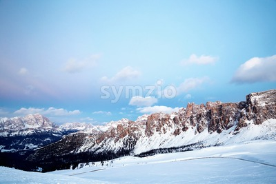 Giau Pass mountains at sunset. Pink warm sky. Italy Stock Photo