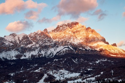 Close up shot of Cortina d'Ampezzo mountains covered in snow at sunset. Italy Stock Photo